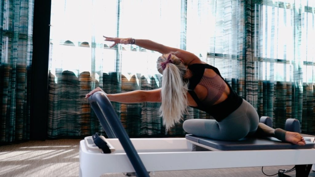 NAC Pilates Room with woman stretching