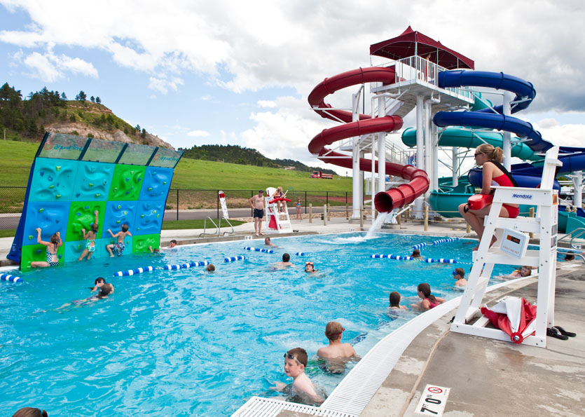 Water park climbing wall and slides