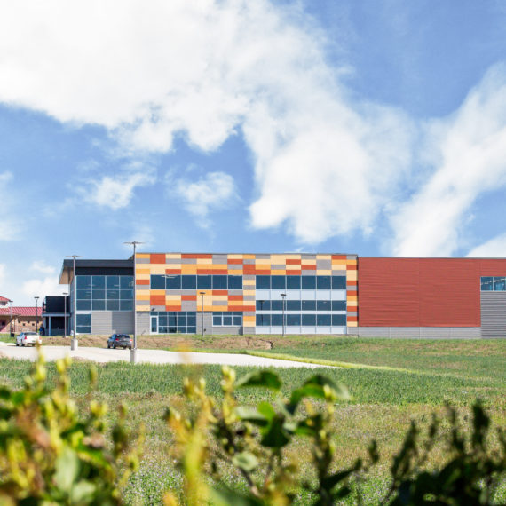 Energy Wellness Center Exterior view with field in foreground