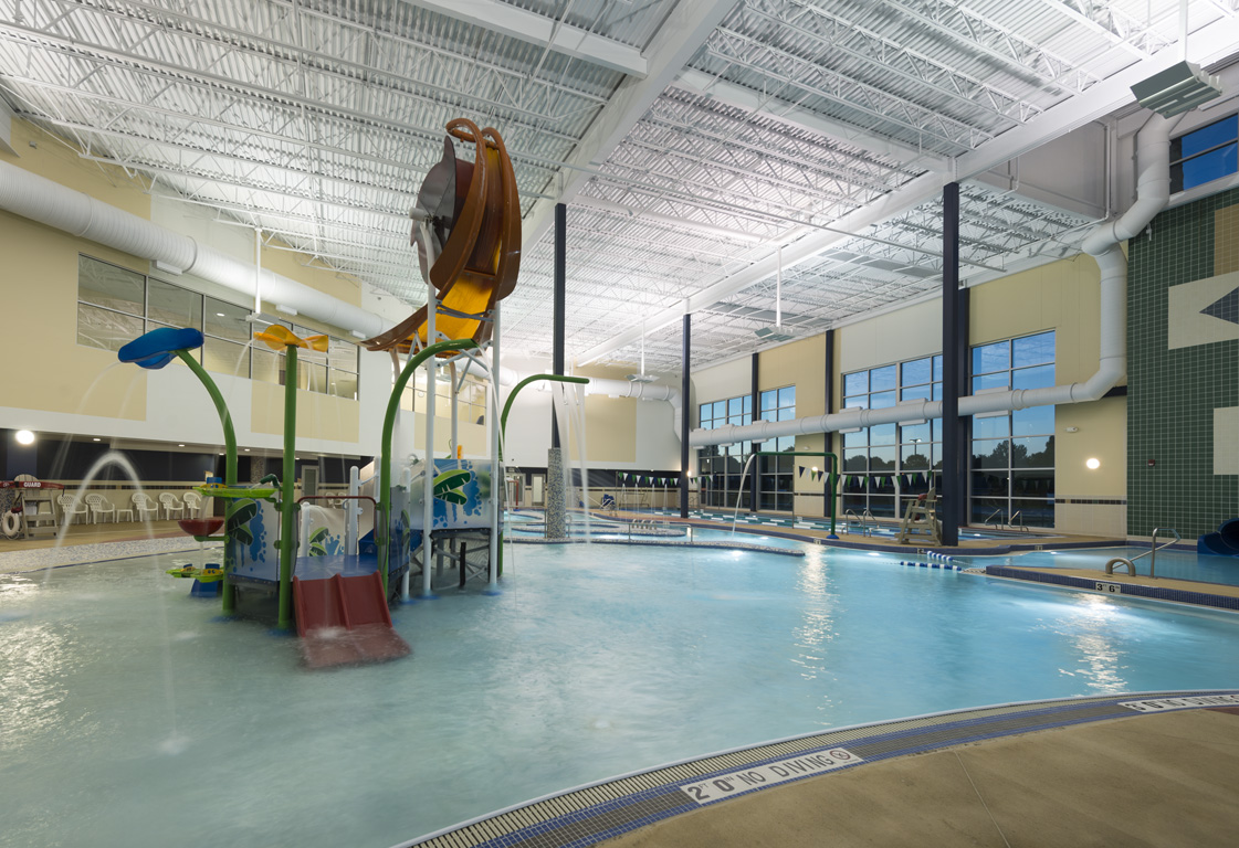 Swimming pool with play features for kids
